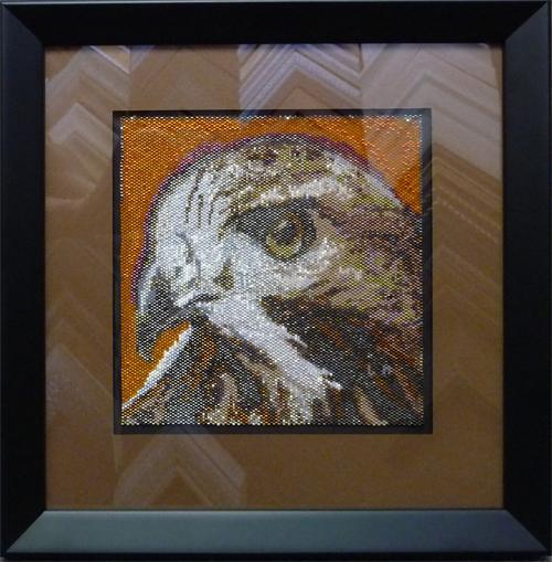 Beaded artwork framed