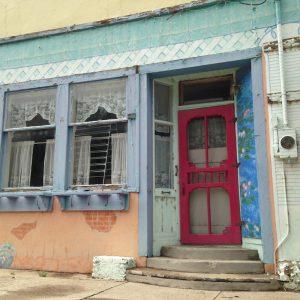 "the ""other door"" of the Barbershop Cafe on Main Street in HIllsboro"