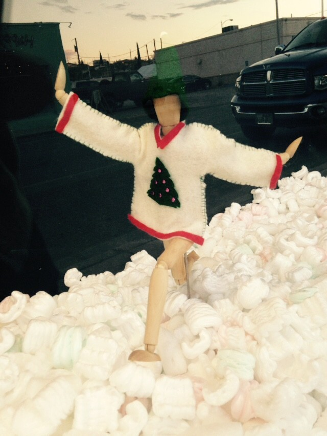 ugly Christmas sweater party in the window at Hot Springs Frame & Art Supply